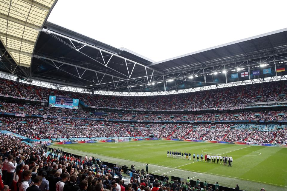 Germany's players, right, stand for the national anthem of their country before the Euro 2020 soccer championship round of 16 match between England and Germany, at Wembley stadium, in London, Tuesday, June 29, 2021. (Matthew Childs/Pool via AP)