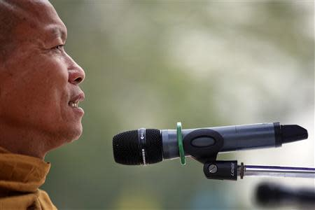 A Buddhist monk and an anti-government protest leader Luang Pu Buddha Issara addresses his supporters from the stage at a protest site in north of Bangkok