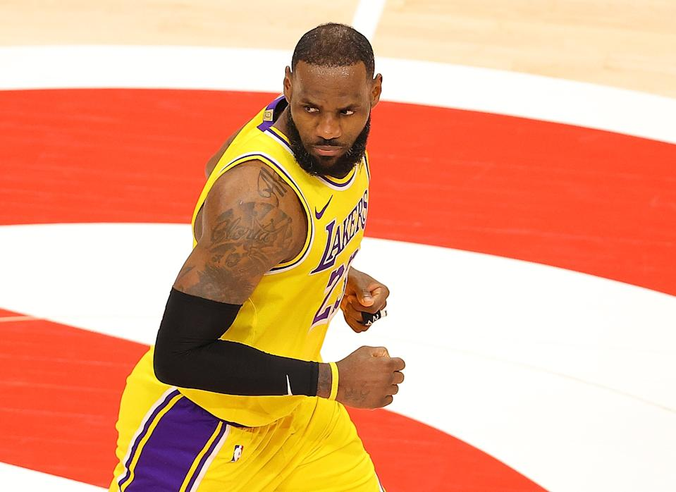 ATLANTA, GEORGIA - FEBRUARY 01: LeBron James #23 of the Los Angeles Lakers reacts after hitting a three-point basket against the Atlanta Hawks during the second half at State Farm Arena on February 01, 2021 in Atlanta, Georgia. NOTE TO USER: User expressly acknowledges and agrees that, by downloading and or using this photograph, User is consenting to the terms and conditions of the Getty Images License Agreement. (Photo by Kevin C. Cox/Getty Images)