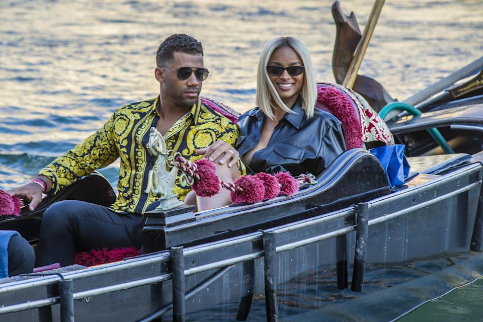 Russell Wilson and Ciara are seen during a gondola tour on the Grand Canal on July 01, 2021, in Venice, Italy