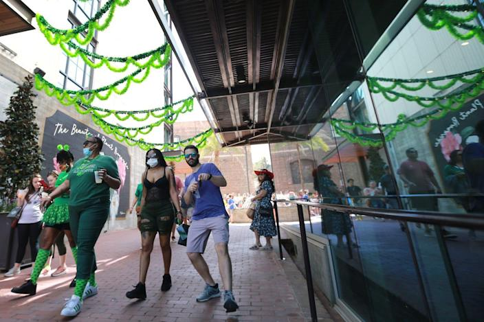 Revelers make their way down to the Plant Riverside St. Patrick's weekend festivities.