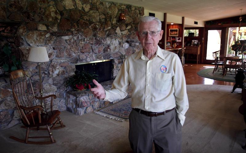 """FILE - In this June 21, 2006 file photo, cartoonist Bil Keane, creator of the comic strip """"Family Circus,"""" poses in his home in Paradise Valley, Ariz. A spokeswoman for King Features Syndicate, the comic strip's distributor, says Keane died Tuesday, Nov. 8, 2011.  He was 89. (AP Photo/East Valley Tribune, Paul O'Neill) MAGS OUT, NO SALES, MANDATORY CREDIT"""