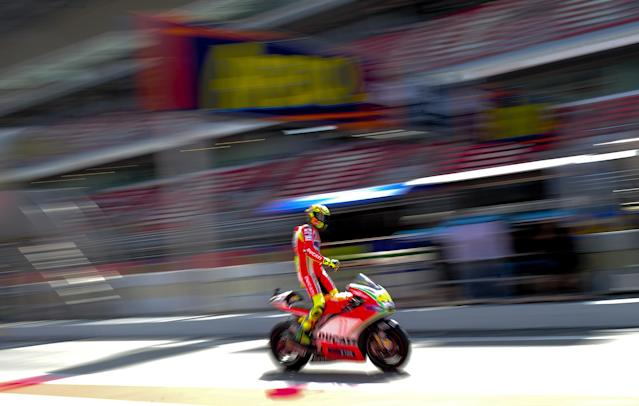TOPSHOTS Ducati Team's Italian Valentino Rossi leaves the pits at the Catalunya racetrack in Montmelo, near Barcelona, on June 2, 2012, during the MotoGP third training session of the Catalunya Moto GP Grand Prix. AFP PHOTO / JOSEP LAGOJOSEP LAGO/AFP/GettyImages