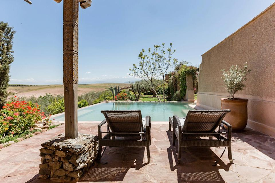 """<p>One of the most luxurious homes on this list, this two-bedroom home just 30 minutes outside of <a href=""""https://www.cntraveler.com/story/what-to-buy-in-marrakech-according-to-garance-dore?mbid=synd_yahoo_rss"""" rel=""""nofollow noopener"""" target=""""_blank"""" data-ylk=""""slk:Marrakech"""" class=""""link rapid-noclick-resp"""">Marrakech</a> offers guests access to a large <a href=""""https://www.cntraveler.com/gallery/13-best-airbnbs-with-private-pools-youll-never-want-to-leave?mbid=synd_yahoo_rss"""" rel=""""nofollow noopener"""" target=""""_blank"""" data-ylk=""""slk:pool"""" class=""""link rapid-noclick-resp"""">pool</a>, private gardens, indoor-outdoor living spaces, and more. It's also family friendly, with a travel crib, high chair, and baby bath available on request. Because of the home's more rural location, the host, Ghizlane, can help you arrange transport from the city and help coordinate any day trips to the surrounding area. </p> <p><strong>Book now:</strong> <a href=""""https://airbnb.pvxt.net/D4LVd"""" rel=""""nofollow noopener"""" target=""""_blank"""" data-ylk=""""slk:From $100 per night, airbnb.com"""" class=""""link rapid-noclick-resp"""">From $100 per night, airbnb.com</a></p>"""