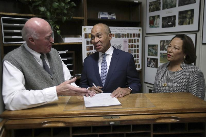 Democratic presidential candidate former Massachusetts Gov. Deval Patrick speaks to New Hampshire Secretary of State Bill Gardner, left, as he files to have his name listed on the New Hampshire primary ballot, Thursday, Nov. 14, 2019, in Concord, N.H. At right is his wife Diane Patrick. (AP Photo/Charles Krupa)