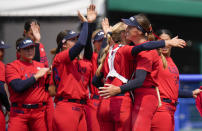 United States players celebrate after defeating Italy in their softball game at the 2020 Summer Olympics, Wednesday, July 21, 2021, in Fukushima, Japan. (AP Photo/Jae C. Hong)