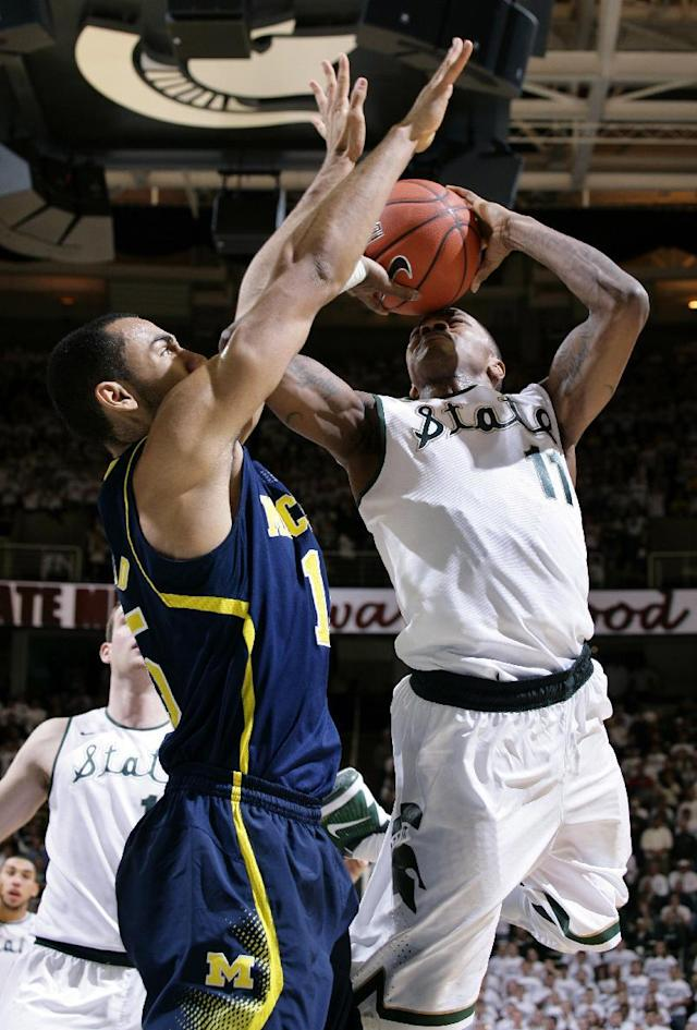 Michigan State's Keith Appling, right, goes for a shot against Michigan's Jon Horford during the second half of an NCAA college basketball game, Saturday, Jan. 25, 2014, in East Lansing, Mich. Michigan won 80-75. (AP Photo/Al Goldis)