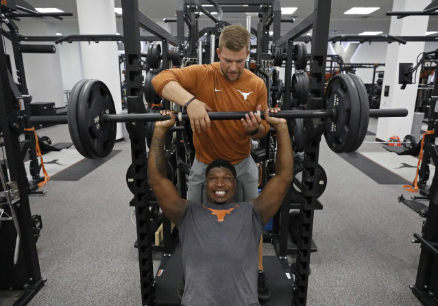 Texas Longhorns assistant strength and conditioning coach Chris Terry spots Jamari Chisholm during a morning workout Wednesday Sept. 4, 2019 in Austin, Tx. ( Photo by Edward A. Ornelas )
