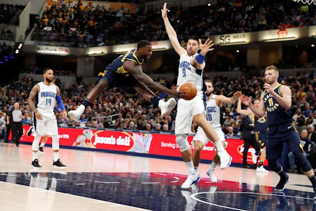 Nov 27, 2017; Indianapolis, IN, USA; Indiana Pacers guard Lance Stephenson (1) makes a pass to forward Domantas Sabonis (11) against Orlando Magic center Nikola Vucevic (9) during the 4th quarter at Bankers Life Fieldhouse. Mandatory Credit: Brian Spurlock-USA TODAY Sports TPX IMAGES OF THE DAY