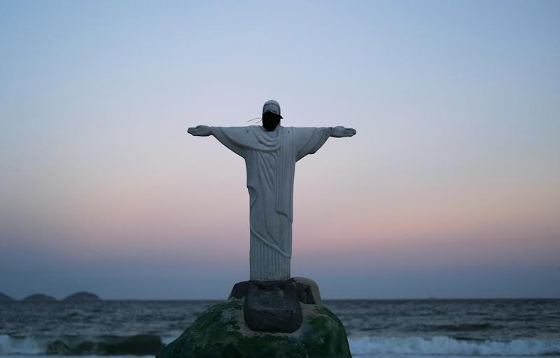 A Christ the Redeemer statue made from sand is pictured with protective mask in Copacabana beach during the coronavirus disease (COVID-19) outbreak, in Rio de Janeiro, Brazil, March 28, 2020. REUTERS/Ricardo Moraes TPX IMAGES OF THE DAY