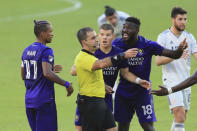Orlando City forward Nani (17) and forward Chris Mueller (9) and forward Daryl Dike (18) argue with referee Alex Chilowicz during the second half of an MLS playoff soccer match against the New England Revolution, Sunday, Nov. 29, 2020, in Orlando, Fla. (AP Photo/Matt Stamey)
