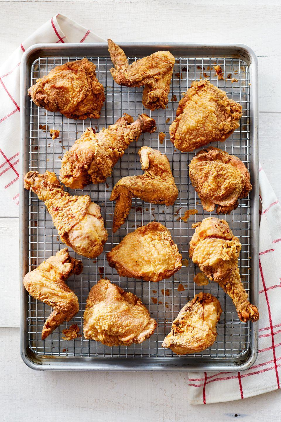 "<p>Finish in the oven to guarantee perfectly cooked chicken and a golden crust.</p><p><strong><a href=""https://www.countryliving.com/food-drinks/recipes/a35600/classic-buttermilk-fried-chicken/"" rel=""nofollow noopener"" target=""_blank"" data-ylk=""slk:Get the recipe."" class=""link rapid-noclick-resp"">Get the recipe.</a></strong></p>"