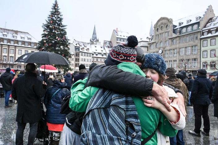 Hundreds of people gathered at the Christmas market in Strasbourg, eastern France, on Sunday to honour the victims of a gunman's shooting spree last week (AFP Photo/SEBASTIEN BOZON)