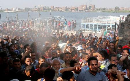 Egyptians shout slogans against the government during the funeral of Syed Tafshan in the south of Cairo