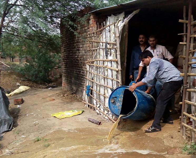 Cheap, locally-made liquor is common in parts of rural India, where bad or adulterated batches can have deadly effects for poor consumers (AFP Photo/STR)