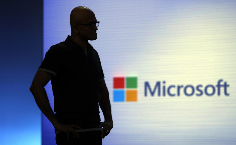 """FILE- In this May 7, 2018, file photo Microsoft CEO Satya Nadella looks on during a video as he delivers the keynote address at Build, the company's annual conference for software developers in Seattle. Amazon and Microsoft are battling for a $10 billion opportunity to build the U.S. military its first """"war cloud."""" (AP Photo/Elaine Thompson, File)"""