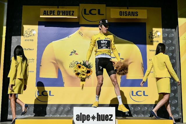 Britain's Geraint Thomas was booed by fans as he stepped on to the podium after winning the gruelling 12th stage of the Tour de France to l'Alpe d'Huez. (AFP Photo/Philippe LOPEZ)