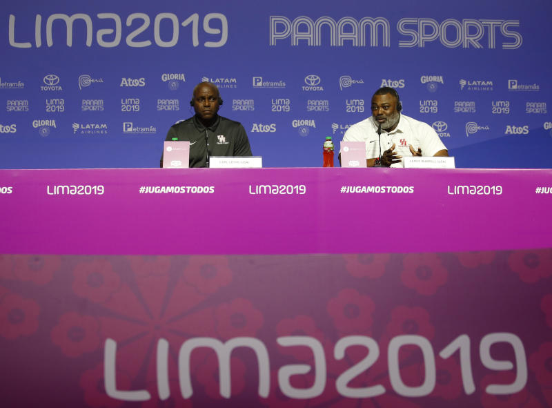 Olympics medalist Carl Lewis, left, and Leroy Burrell, both from the United States, give a press conference during the Pan American Games in Lima, Peru, Monday, Aug. 5, 2019. Lewis said that if it wasn't for his mother, who competed in the first Pan Am Games in 1951, he would have never chosen athletics. (AP Photo/Moises Castillo)