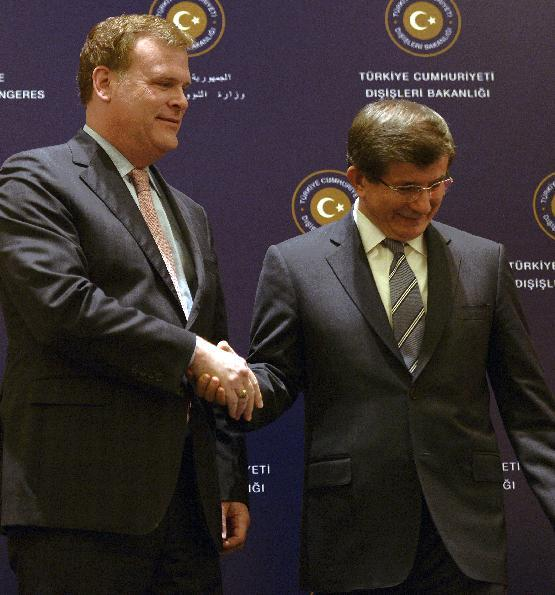 Canadian Foreign Minister John Baird, left, and his Turkish counterpart Ahmet Davutoglu shake hands in front of the media during a news conference after talks on security and terror threats in the mideast region, in Istanbul, Turkey, Saturday, Sept. 14, 2013. Baird is in Turkey for talks on security issues including the ongoing situation in Syria. (AP Photo)