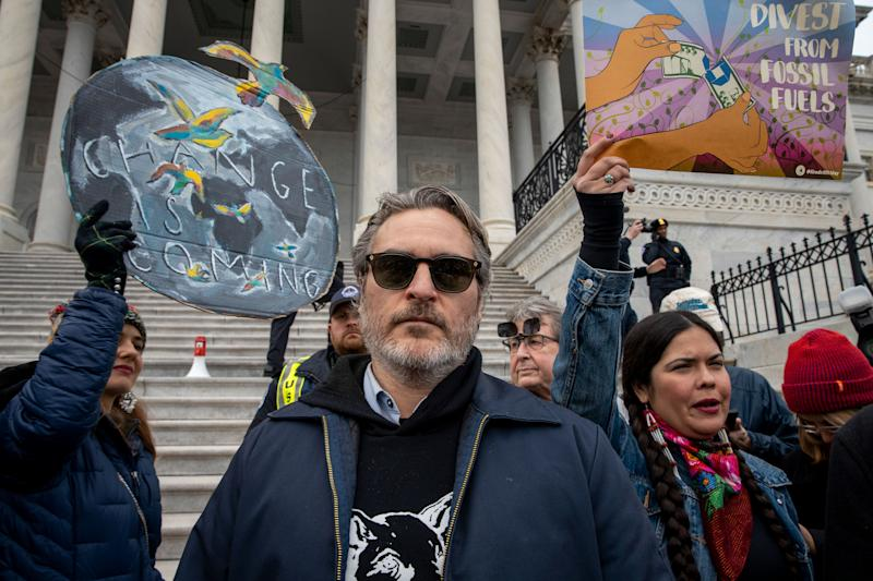 Joaquin Phoenix and other protesters outside the Capitol, and he looks amazing.