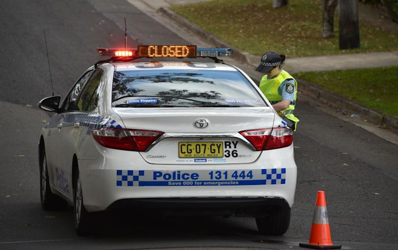 A policewoman standing next to a police car in Sydney on July 6, 2018.