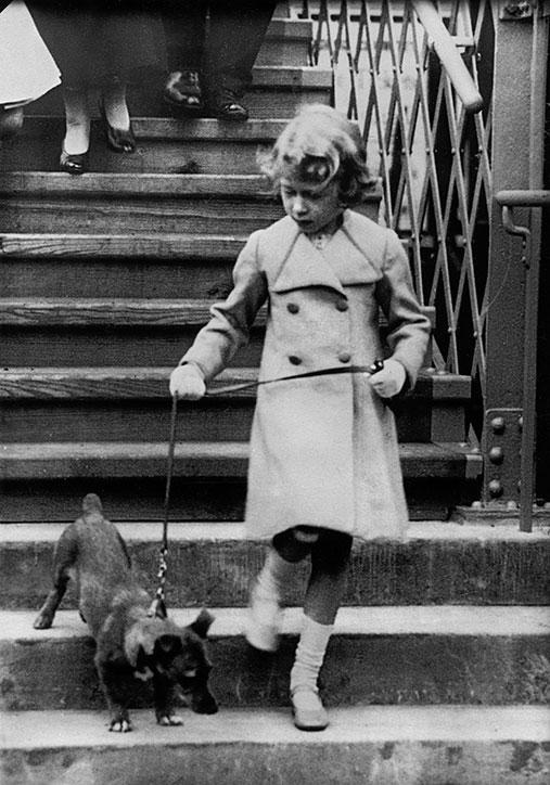 The Queen has always been surrounded by her favourite pooches. Here she is walking one of her pets in 1931, aged five.
