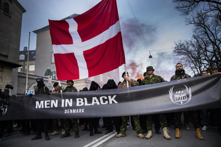 The group Men in Black protest in the streets of Copenhagen on Saturday, April 10, 2021. Men in Black were protesting about Denmark's COVID-19 restrictions. (Martin Sylvest/Ritzau Scanpix via AP)