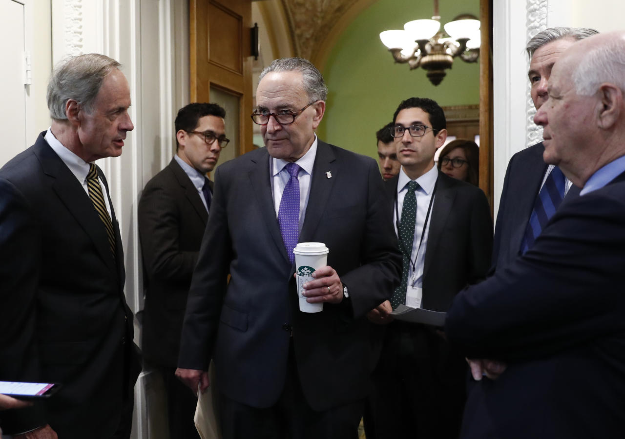 From left, Sen. Tom Carper, D-Del., Senate Minority Leader Charles Schumer of N.Y., Sen. Sheldon Whitehouse, D-R.I., and Sen. Ben Cardin, D-Md., talks as they arrive on Capitol Hill in Washington, Wednesday, May 24, 2017, for a news conference on the Paris Climate Agreement. (AP Photo/Carolyn Kaster)