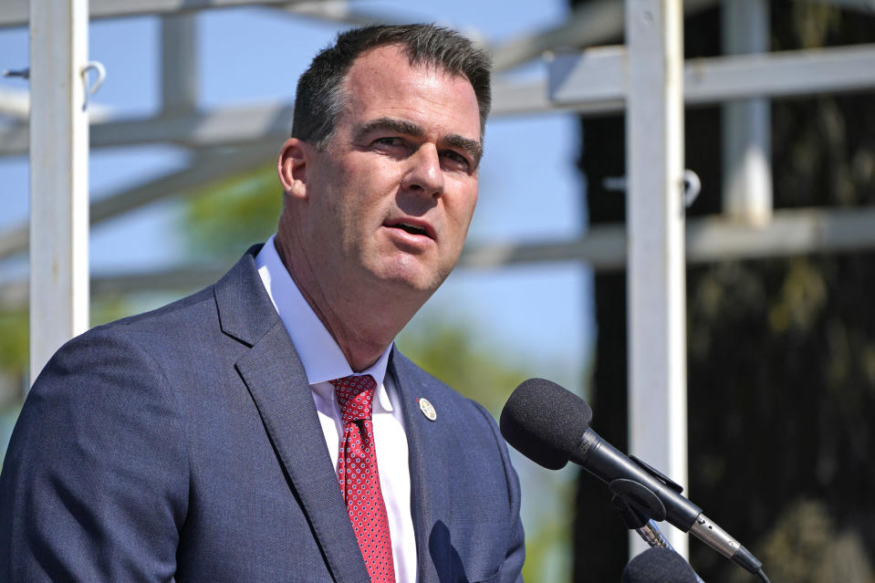 FILE - In this May 7, 2021, file photo, Oklahoma Gov. Kevin Stitt speaks during an Oklahoma Law Enforcement Memorial Ceremony in Oklahoma City. Stitt signed a bill late Tuesday, May 11, 2021, to add one day of early, in-person voting from 8 a.m. to 6 p.m. on the Wednesday before a presidential election. (AP Photo/Sue Ogrocki File)