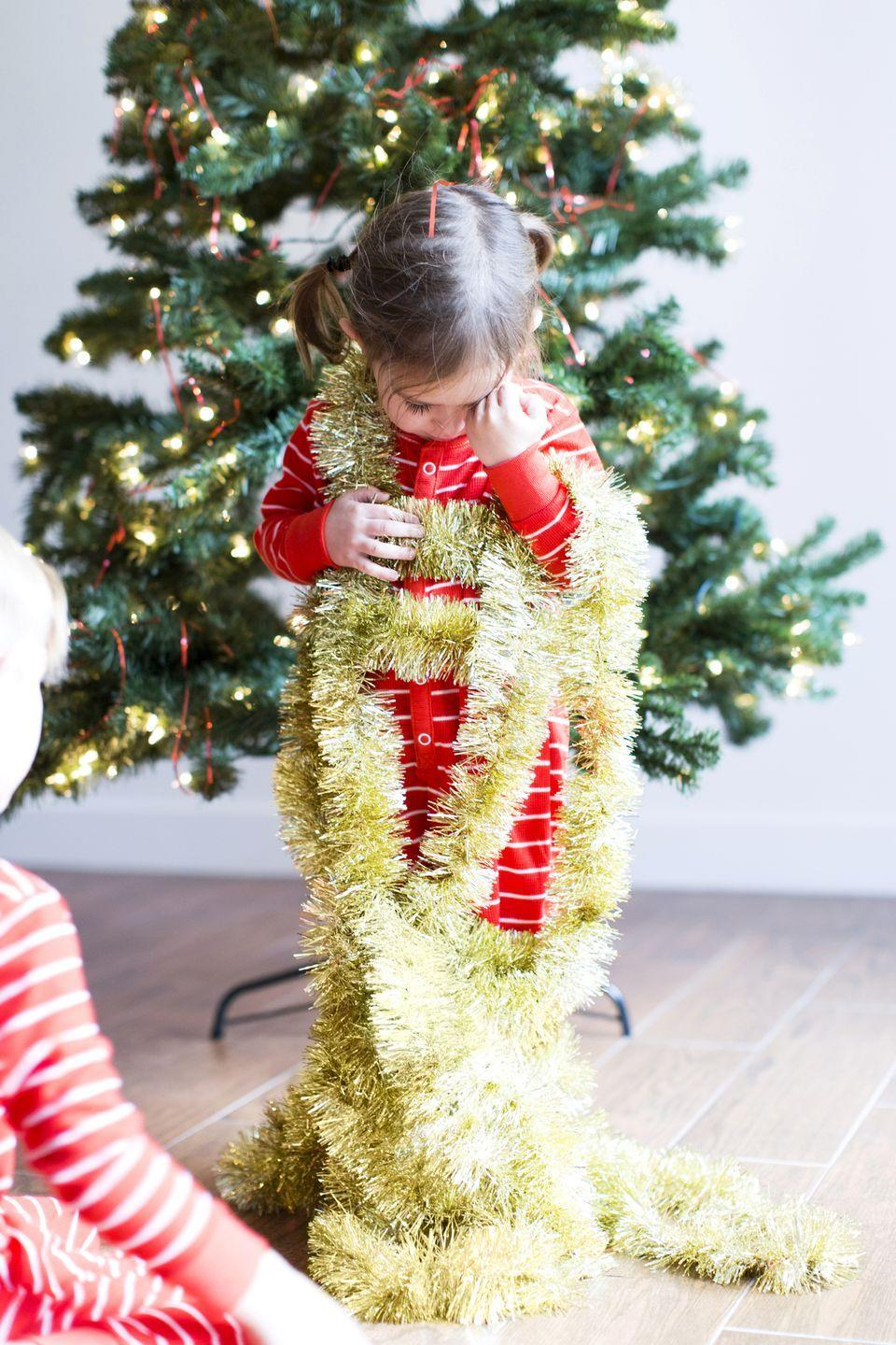 "<p>Tinsel was invented in 1610 in Germany and was originally spun from real silver, making it far from the chintzy decoration it is now. It also has an edgy history. The U.S. government <a href=""https://www.history.com/topics/christmas/history-of-christmas-trees"" rel=""nofollow noopener"" target=""_blank"" data-ylk=""slk:once banned tinsel"" class=""link rapid-noclick-resp"">once banned tinsel</a> because it contained poisonous lead. But never fear; now it's made of plastic. However, you should still use caution if you have pets or small children, since it's still harmful if swallowed. </p>"