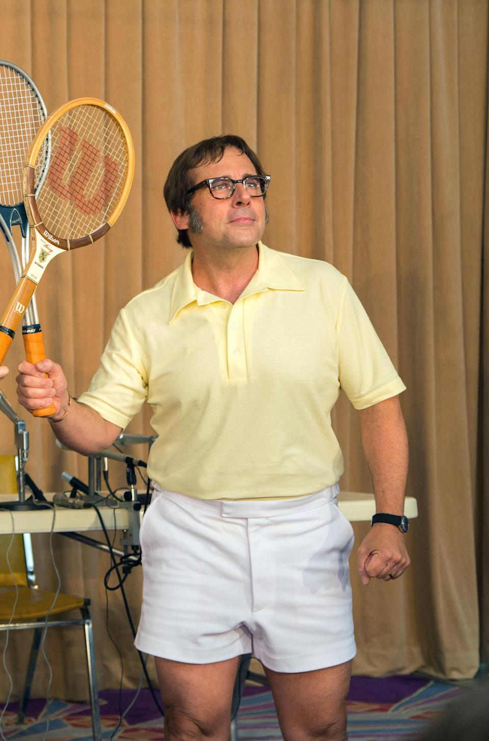 Bobby Riggs posing with his tennis racket in the air