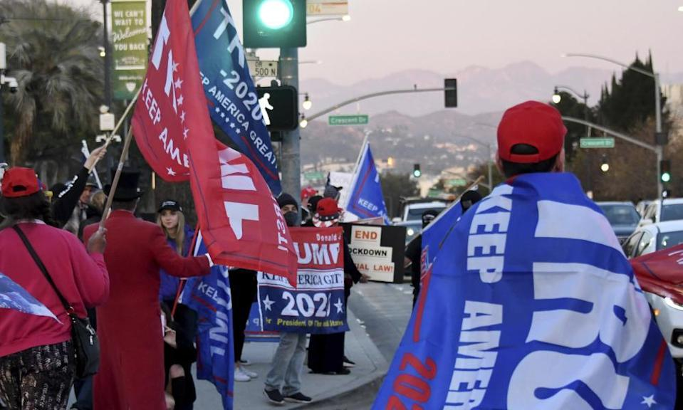 Protesters at a pro-Trump rally in Beverly Hills. Three of the 14 California residents charged in connection with the US Capitol attack are from the wealthy Los Angeles county enclave.