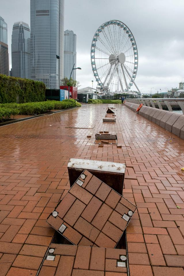 <p>Pavement on the waterfront in Central Hong Kong are displaced as Typhoon Hato hits land in Hong Kong causing a signal 10 Tropical cyclone on Aug. 23, 2017. (Photo: Jayne Russell via ZUMA Wire) </p>