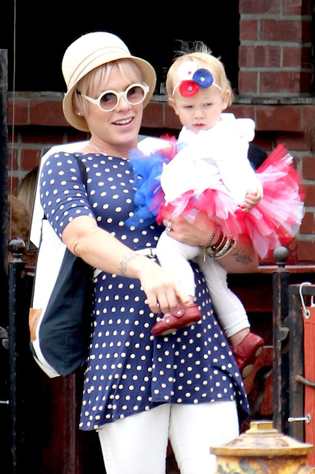 """Pink and her 13-month-old daughter, Willow, showed some adorable holiday spirit. The """"So What"""" singer went for blue-and-white polka dots, while her mini-me complemented her mama in red and white ... and a too-cute tutu ... during a family celebration in Los Angeles."""