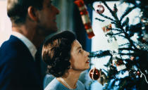 Christmas at Windsor Castle with the Queen and Prince Philip putting finishing touches to Christmas tree in 1969. (PA/The Royal Family)