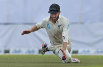 New Zealand's captain Kane Williamson fields a ball during the fourth day of the first test cricket match between Sri Lanka and New Zealand in Galle, Sri Lanka, Saturday, Aug. 17, 2019. (AP Photo/Eranga Jayawardena)