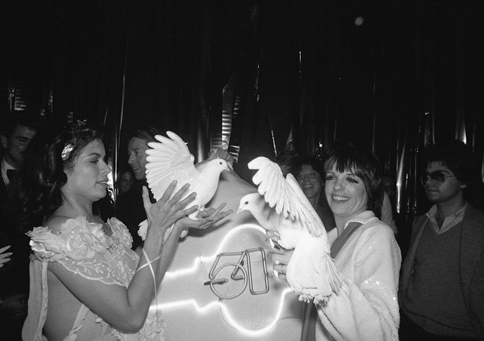 <p>Bianca Jagger and Liza Minnelli holding white doves at Studio 54 in New York City, 1977. </p>