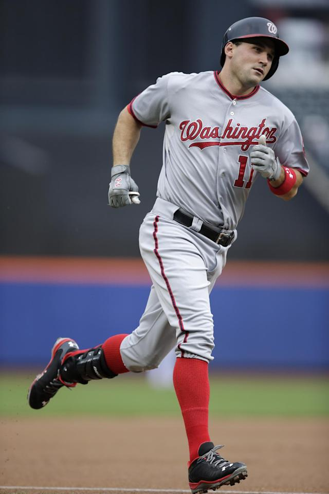 Washington Nationals' Ryan Zimmerman trots the bases after hitting a solo home run off New York Mets starting pitcher Aaron Harang during the first inning of a baseball game Thursday, Sept. 12, 2013, in New York. (AP Photo/Kathy Willens)