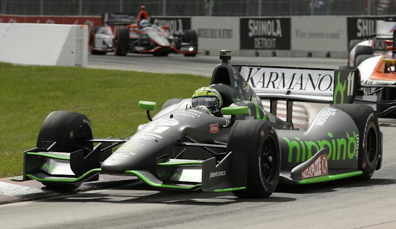 Tony Kanaan (11) races during the IndyCar Detroit Grand Prix auto race on Belle Isle in Detroit Sunday, June 2, 2013. (AP Photo/Paul Sancya)