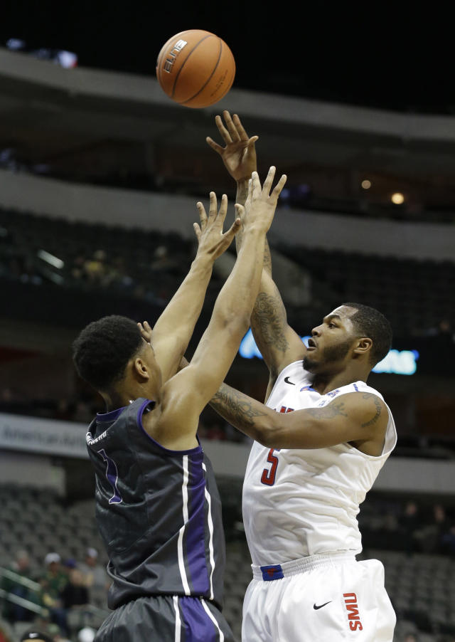 SMU forward Markus Kennedy (5) shoots against TCU forward Brandon Parrish, left, during the first half of an NCAA college basketball game in Dallas, Friday, Nov. 8, 2013. (AP Photo/LM Otero)