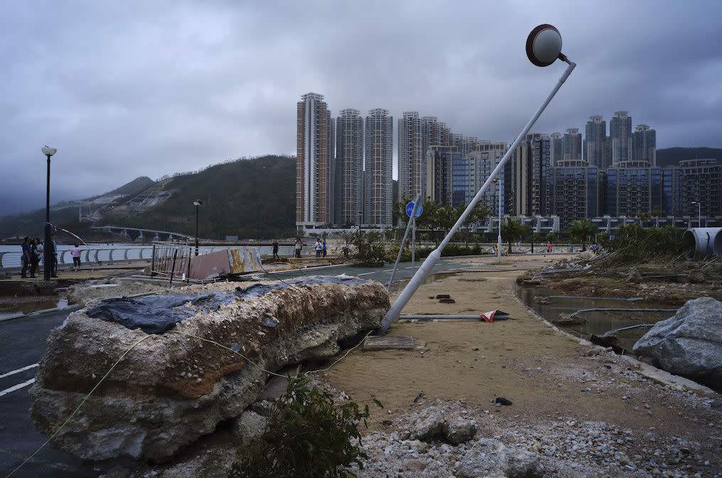 <p>Debris caused by Typhoon Mangkhut is seen outside a housing estate on the waterfront in Hong Kong (Picture: AP) </p>