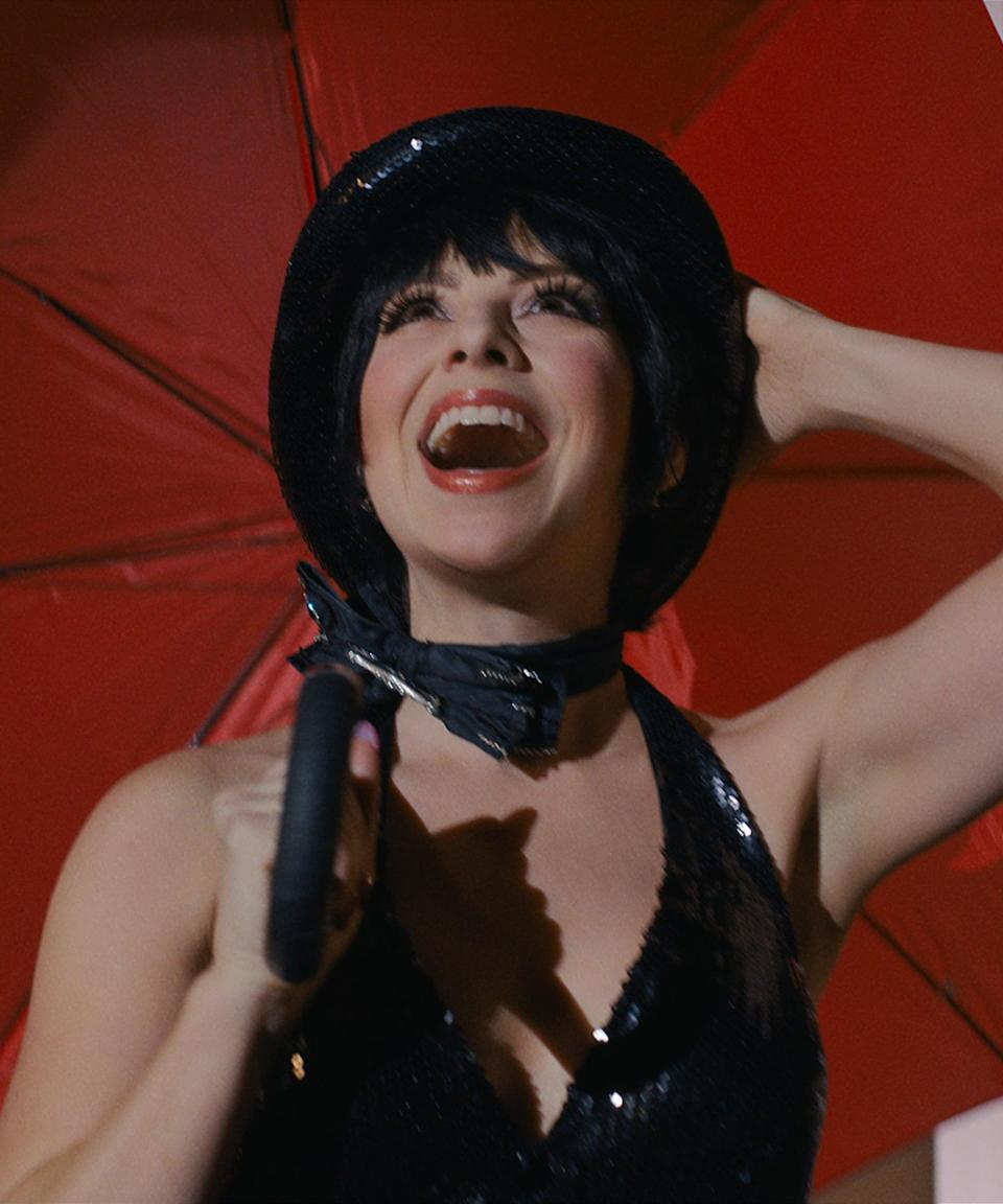 """<h2>Krysta Rodriguez as Liza Minnelli</h2><br><em>Smash</em> stans know all about Rodriguez, as she joined the beloved, but short-lived NBC series in the second season as Ana Vargas — and Rodriguez is really a Broadway star, too. She's appeared in productions of <em>Spring Awakening</em>, <em><a href=""""https://www.refinery29.com/en-gb/2021/03/10367938/in-the-heights-movie-trailer-lin-manuel-miranda-anthony-ramos"""" rel=""""nofollow noopener"""" target=""""_blank"""" data-ylk=""""slk:In The Heights"""" class=""""link rapid-noclick-resp"""">In The Heights</a></em>, and most recently in The Public Theater's production of <em>Hercules</em>, in which she played Megara. ON TV, she's appeared on <em>Younger</em>, <em>Quantico</em>, and Netflix's jukebox series <em>Soundtrack</em>. <br><br>Taking on the role of Minnelli was a dream for Rodriguez, who loved dressing up in some of the performer's most memorable looks. """"It was fun to see how accurate we can get,"""" <a href=""""https://www.vogue.com/slideshow/halston-star-krysta-rodriguez-premiere-fashion-diary"""" rel=""""nofollow noopener"""" target=""""_blank"""" data-ylk=""""slk:Rodriguez told"""" class=""""link rapid-noclick-resp"""">Rodriguez told </a><em><a href=""""https://www.vogue.com/slideshow/halston-star-krysta-rodriguez-premiere-fashion-diary"""" rel=""""nofollow noopener"""" target=""""_blank"""" data-ylk=""""slk:Vogue"""" class=""""link rapid-noclick-resp"""">Vogue</a></em>, noting the series' dedication to using reference image to get the Halston looks just right. And once she was in some of these famous outfits, Rodriguez told the magazine she felt even more connected to Minnelli: """"You watch her performances, and she's not worried about how perfect she looks — she wants to get that guttural emotion across."""" <span class=""""copyright"""">Photo: Courtesy of Netflix.</span>"""
