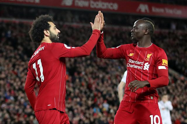 Mohamed Salah (11) and Sadio Mane look to lead Liverpool past bitter rival Manchester United on Sunday. (Action Images via Reuters/Carl Recine)