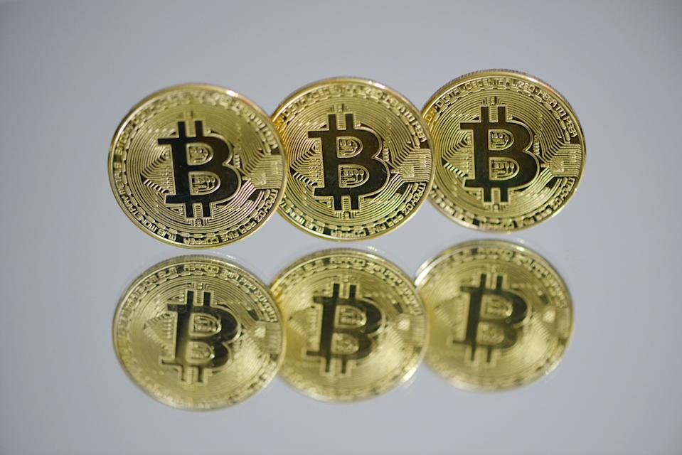 CHINA - 2021/03/13: In this photo illustration the Bitcoins are seen on display. (Photo Illustration by Sheldon Cooper /SOPA Images/LightRocket via Getty Images)