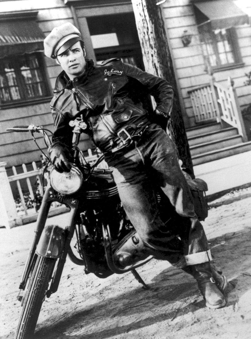 <p>Film's notorious bad boy, Marlon Brando, is tough as nails, as he drives his motorcycle through the streets of Paris in <em>The Wild One</em>.</p>