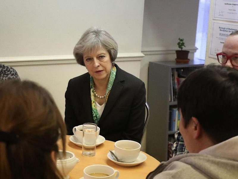 Theresa May visits a community mental health support centre, having promised to 'transform' attitudes to mental health problems (Getty)