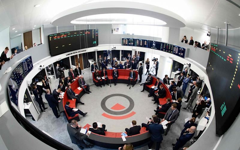 Traders operate in the Ring, the open trading floor of the new London Metal Exchange (LME) in central London.  - AFP
