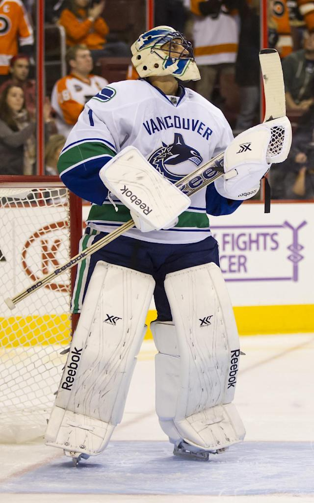 Vancouver Canucks goalie Roberto Luongo looks up at a replay after giving up a goal to Philadelphia Flyers' Tye McGinn during the second period of an NHL hockey game, Tuesday, Oct. 15, 2013, in Philadelphia. (AP Photo/Chris Szagola)