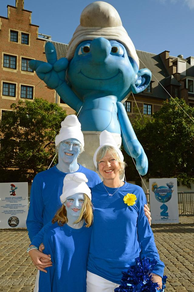 BRUSSELS, BELGIUM - JUNE 22: (L-R) Marc Guerin, Nina Guerin Culliford and Veronique Culliford, the daughter of cartoonist Peyo, the creator of The Smurfs, pose by a giant Smurf character during Global Smurfs Day celebrations on June 22, 2013 in Brussels, Belgium. (Photo by Pascal Le Segretain/Getty Images for Sony Pictures Entertainment)