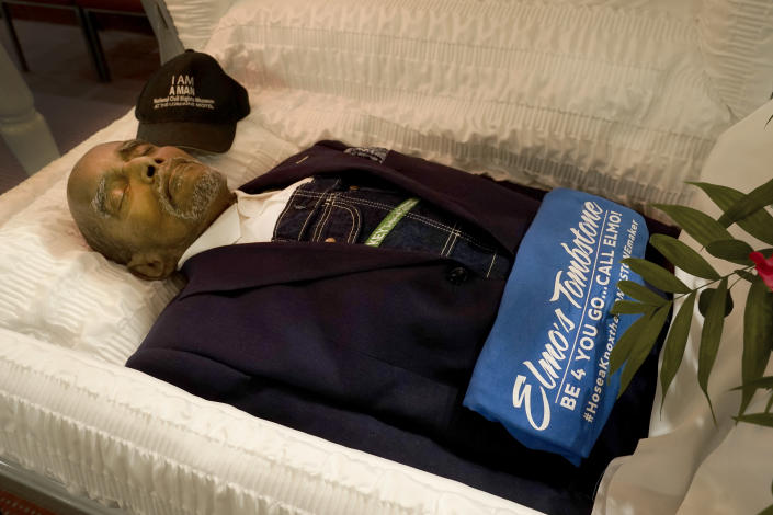 Wearing his trademark overalls, Hoses Knox, 82, proprietor of Elmo's Tombstones, lies in his casket for friends and family to pay their respects at his funeral Monday, Sept. 13, 2021, in Chicago. Knox, 82, who died on Sept. 5, 2021, served the predominately Black community in their time of need for more than 33 years. (AP Photo/Charles Rex Arbogast)
